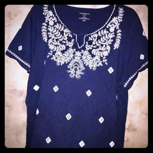 Navy blue blouse with with white diamond accents.